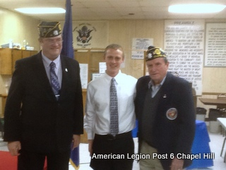 Alex Werden is flanked by Commander Heavlin and Bud Hampton