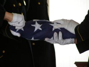 Karl Fritz flag folding at Arlington National Cemetery. Photo by Leanna Elise Long, 2007